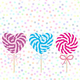 Valentine`s Day Heart shaped  Set candy lollipops with bow, spiral candy cane. Candy on stick with twisted design on white abstrac Royalty Free Stock Images