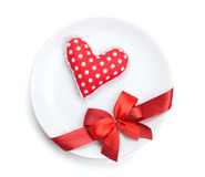 Valentine's Day heart shaped toy over plate with red bow Royalty Free Stock Photo