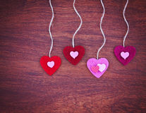 A valentine's day heart on a wooden background toned with a retr Stock Photos
