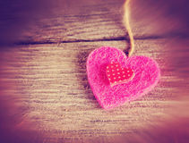 A valentine's day heart on a wooden background toned with a retr Royalty Free Stock Image