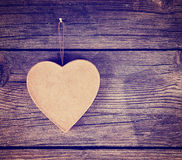 A valentine's day heart on a wooden background toned with a retr Stock Images