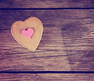 A valentine's day heart on a wooden background toned with a retr Royalty Free Stock Photo