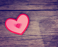 A valentine's day heart on a wooden background toned with a retr Royalty Free Stock Images