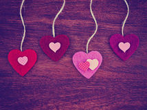 Valentine's day heart on a wooden background toned with a retr Stock Photo