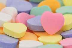 Valentine's Day Hearts. Close up of conversation hearts, with room for personalized text on the pink heart Stock Photo
