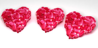 Valentine's Day hearts. Three pink and red Valentine's Day hearts against white background Stock Photos