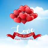 Valentine`s day with hearts balloon and ribbon on blue sky background Stock Photo
