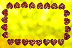 Valentine`s day hearts frame, lights background bokeh. Frame for holiday pictures or important text, colored lights in the frame. Of hearts, the decoration of stock image