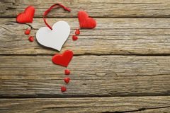 Valentine`s day,hearts on old wooden floor. Valentine`s day, hearts on old wooden table royalty free stock image