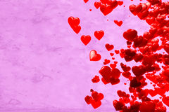 Valentine's Day Hearts. Red Hearts for Valentine's day, scattered over violet grunge background Stock Photo