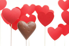 Valentine's day hearts on a stick with chocolate heart. Isolated on light background Stock Photo