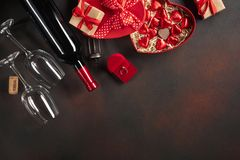 Valentine`s Day with hearts, wine, corkscrew, glasses, gifts, a heart-shaped box and a blackboard. Top view with copy space stock photography