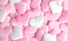 Valentine`s Day. Holiday abstract pink Valentine background with satin hearts. Love. Concept royalty free stock images