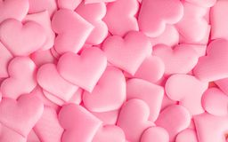 Valentine`s Day. Holiday abstract pink Valentine background with satin hearts. Love. Concept stock photo