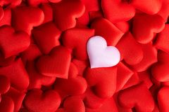 Valentine`s Day. Holiday abstract red Valentine background with satin hearts. Love stock images
