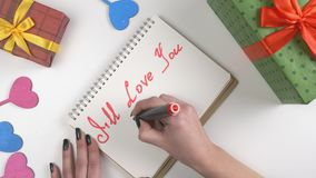Valentine`s Day, illustration, woman`s hand writes in a notebook, I will love you till the end 60 fps. Valentine`s Day, illustration, woman`s hand writes in a stock video