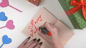 Valentine`s Day, illustration, woman`s hand writes in a dark brown notebook, Happy Valentine`s day 60 fps. Valentine`s Day, illustration, woman`s hand writes in stock video