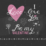 Valentine's Day lettring on a chalkboard. Valentine's Day lettering, vector handwritten greetings, Valentine Day greeting card, romantic lettering with hearts Stock Photos