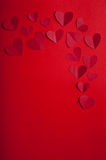 Valentine's Day. Little red hearts on a red background Royalty Free Stock Photography