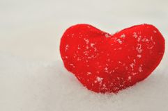 Valentine`s day and Love composition with red plush heart on snow. Healthy lifestyle concept. stock image
