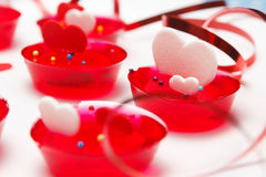 Valentine's day love gelatin deserts. Plate of Valentine's day love gelatin deserts with red and white hearts and ribbon Royalty Free Stock Images