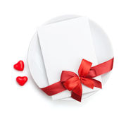 Valentine's Day love letter over plate with red bow Royalty Free Stock Photography