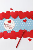 Valentine's day love message. Handmade, with pencils and hearts  on blue with white dots background (polka dot) with white borders Royalty Free Stock Images