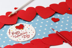 Valentine's day love message. Handmade, with pencils and hearts  on blue with white dots background (polka dot) with white borders Stock Photos