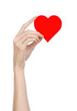 Valentine's Day and love theme: hand holding a red heart isolated on a white background Royalty Free Stock Images