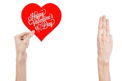 Valentine's Day and love theme: hand holds a greeting card in the form of a red heart with the words Happy Valentine's day Stock Photography