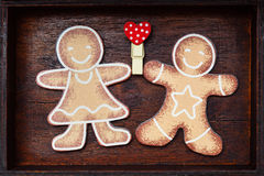 Valentine`s Day. Lovers gingerbread men holding red heart love symbol Royalty Free Stock Photos