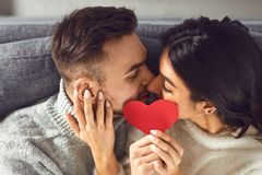 Free Valentine`s Day. Loving Couple With Hearts In Hand Kisses In The Room Royalty Free Stock Photo - 168166895