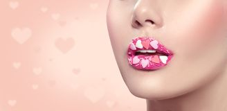 Valentines Day makeup. Lips with pink hearts sugar sprinkles. Valentine hearts sweet makeup Royalty Free Stock Photos