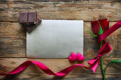 Valentine`s day, maroon rose, red silk ribbon Royalty Free Stock Photo
