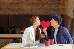 Valentine Day man gave the red heart to girl to show love. Valentine`s Day men gave the red heart to girl to show love royalty free stock images