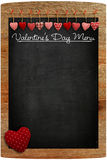Valentine's Day Menu Chalkboard Fabric Love hearts hanging on wo. Oden texture background, big red heart  in corner, copy space for love message Stock Photography