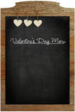 Valentine's Day Menu Chalkboard White Love hearts hanging on woo Royalty Free Stock Photography