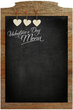 Valentine's Day Menu Chalkboard White Love hearts hanging on woo Royalty Free Stock Photo