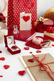 Valentine's day mess. Composition of many festive objects-gift boxes, presents, greeting cards, ribbons and jewellery Stock Photography
