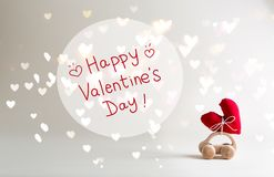 Valentine`s Day message with toy car carrying a heart. Cushion royalty free stock photos