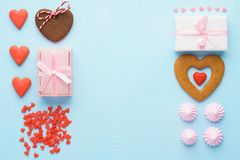 Valentines Day objects collection. Pastel pink and blue colors. Valentines Day objects collection. Gift boxes, heart shaped cookies, meringues and candy. Pastel stock image