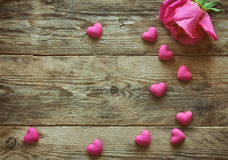 Valentine`s day, one pink rose, many heart Stock Photography