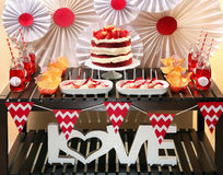 Valentine's Day party table with red velvet cake Stock Photos