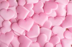 Valentine`s Day. Pink heart shape backdrop. Abstract holiday Valentine background with pink satin hearts. Love concept. Flat lay, top view stock image