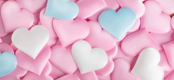 Valentine`s Day. Pink heart shape backdrop. Abstract Valentine background with pink, white and blue pastel color satin hearts. Valentine`s Day. Pink heart shape stock photography