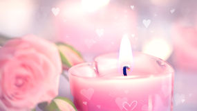 Valentine's Day. Pink heart shaped candles and roses Stock Photography