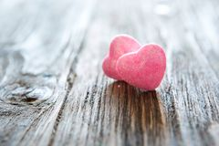 Valentine`s day pink hearts on wooden background. Valentine`s day holiday concept stock photo