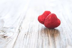 Valentine`s day red hearts on wooden background. Valentine`s day holiday concept stock photography