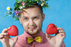 Valentine's day. Portrait of a man in love with two hearts Stock Photos