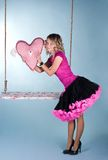 Valentine's day: pretty girl with pink heart. Valentine's day: young beautiful woman Royalty Free Stock Photos